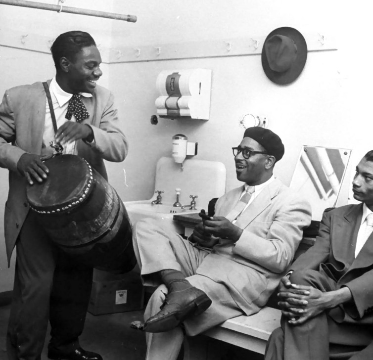 jungle-type-drum-being-played-by-drummer-of-dizzy-gillespies-band-he-beats-on-the-drum-with-his-hands-instead-of-a-drum-sticks-0