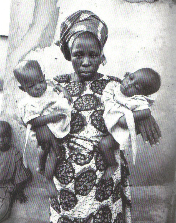 Yoruba_woman_holding_twins